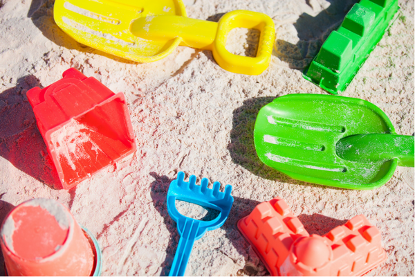 colorful beach toys on the sand