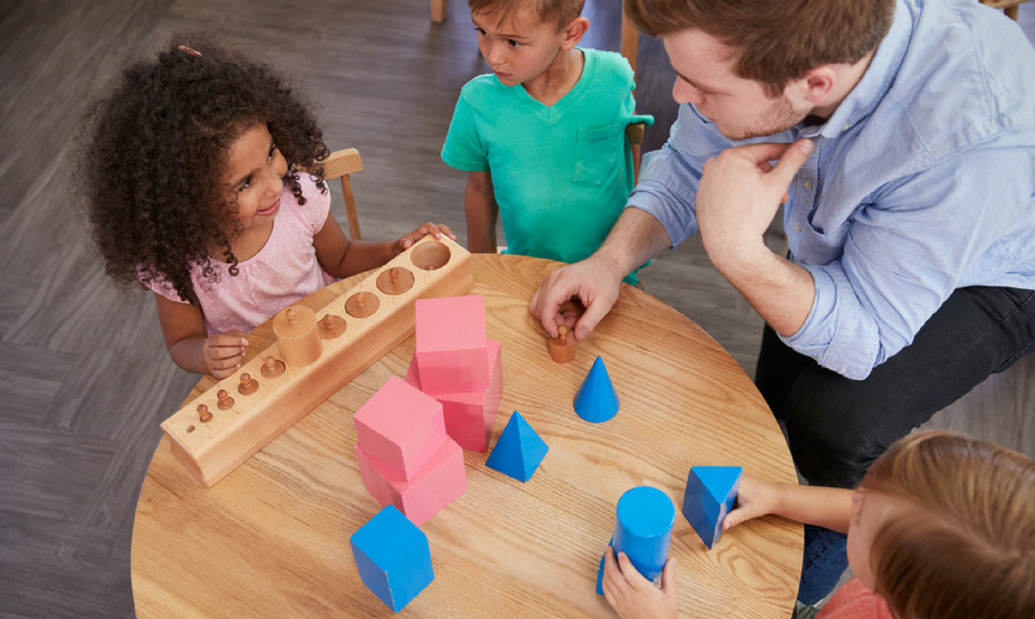Preschool kids and teacher with blocks