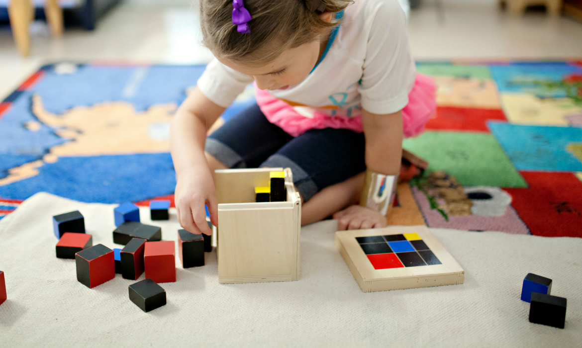 young girl playing with blocks