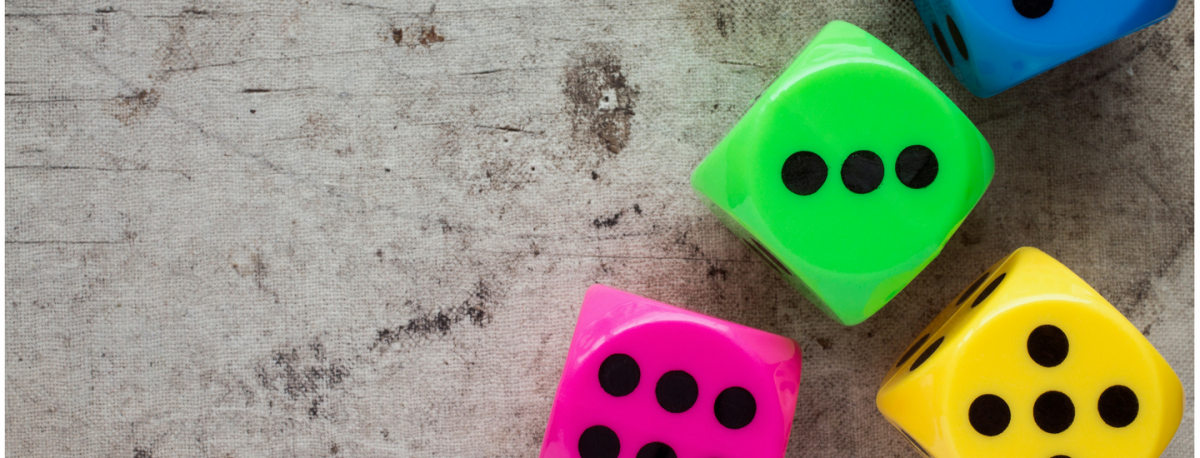 Image of colorful dice announcing new early math materials in operations