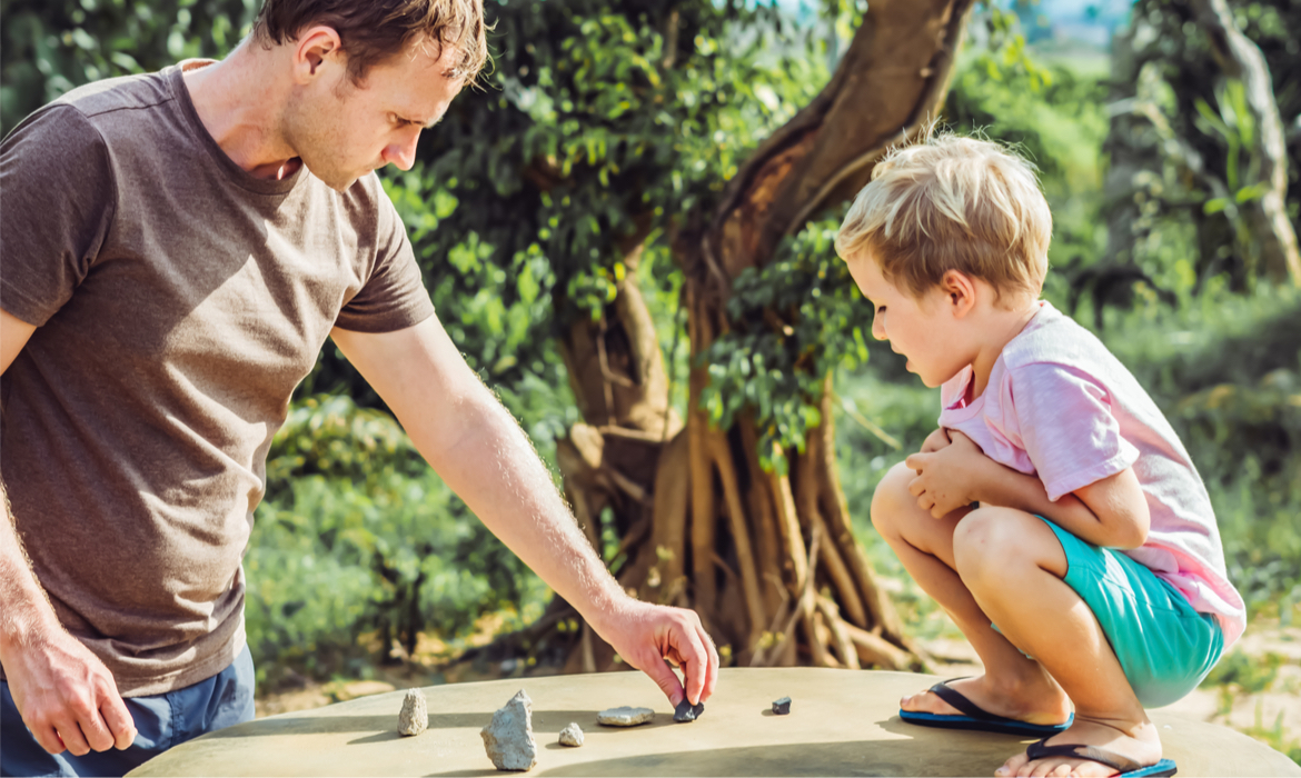 Father son play outside and talk about math on sunny day