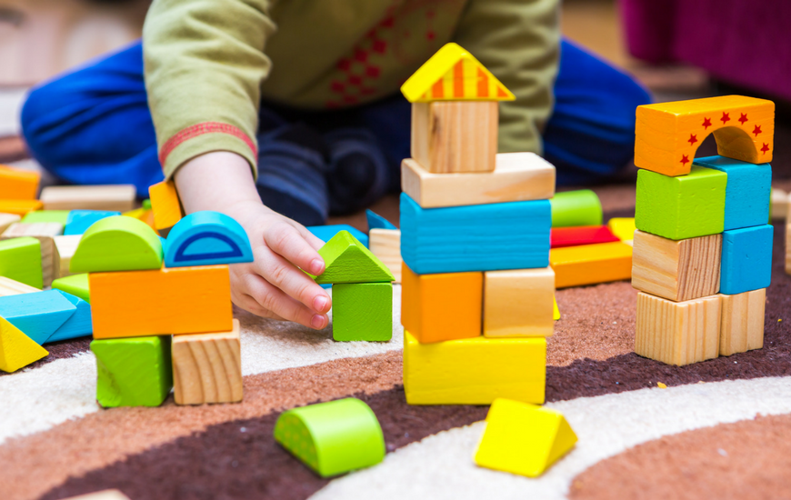 Young child playing with blocks