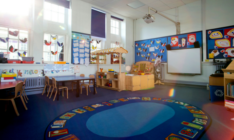 Preschool classroom with circle time rug
