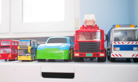 toy cars and trucks organized by size